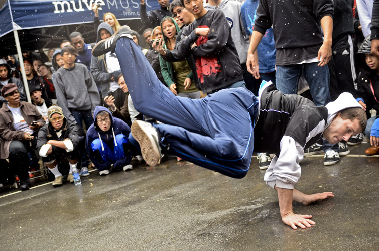 Brandon Rapp, a Baltimore-native and member of breakdance crew, the Incredible Sushi Kings, stuns the crowd during the B-Boy Battle at the Crafty Bastards Festival in the Adams Morgan neighborhood of Washington, D.C.
