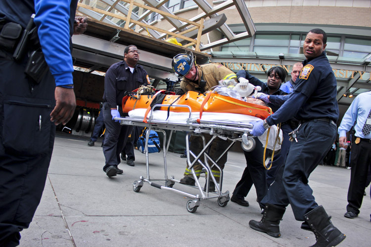 Medics emerge from the Foggy Bottom Metro station with an unidentified male who was struck by a train after he appeared to intentionally step on to the tracks. He was pronounced dead upon arrival at GW Hospital, Washington Metropolitan Area Transit Authority spokesman Dan Stessel said.