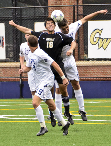 Matthew Scott collides with a Bryant opponent for a header during an intensely physical match that saw GW score the game-winning goal with just 1:36 left in play.
