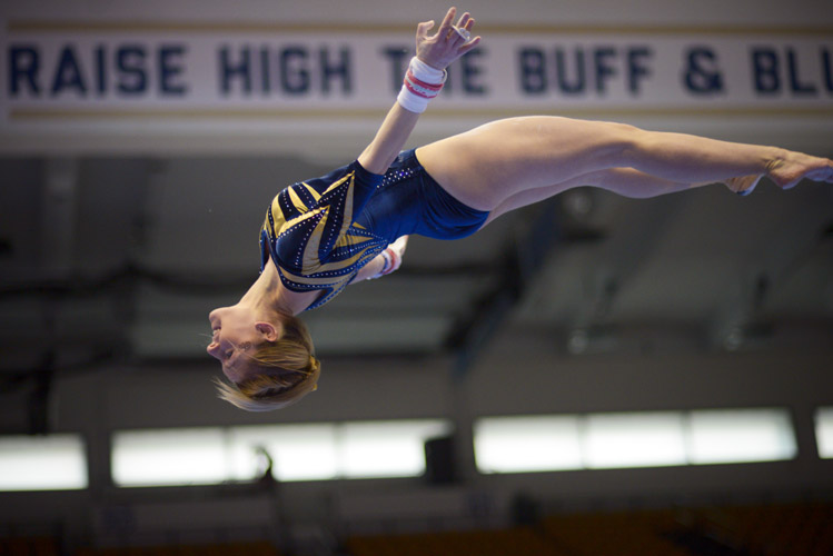 Taylor Redmond goes airborne as she dismounts from the uneven bars. She placed fifth in the event with a score of 9.70.