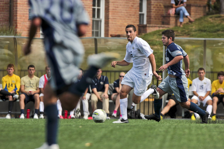 Midfielder Zach Abaie looks for an open man, trying to create a play during a game against Longwood.