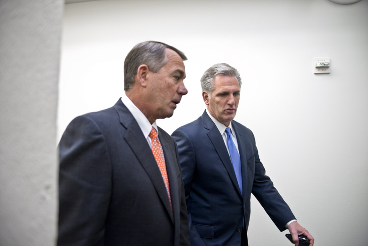 The Speaker walks down a Capitol corridor with Majority Leader Kevin McCarthy. McCarthy ascended to the post of BoehnerÕs second-in-command earlier in the year after the previous leader, Eric Cantor, was stunningly defeated in the Republican primary by Dave Brat. Brat won by convincing the electorate that Cantor was too willing to compromise on important issues.