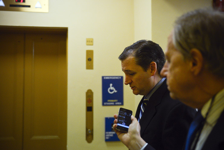 Sen. Ted Cruz, one of the most ardent opponents of the Obama Administration's immigration policies, speaks with a reporter on his way to the Senate. Cruz is open about his willingness to use any strategy – no matter how unpopular – to reverse the President's actions. For example, Cruz expressed his readiness to risk a shutdown of the Department of Homeland Security or his call to reject Loretta Lynch's nomination as attorney general because of her support for Obama.