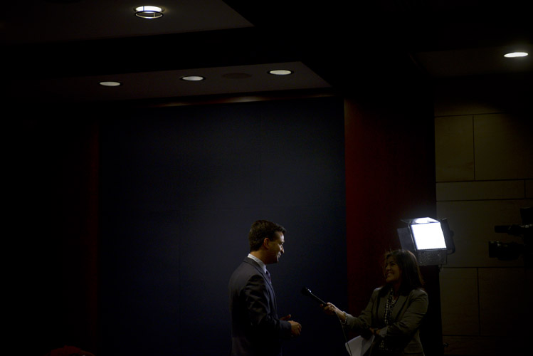 Rep. Carlos Curbelo, one of the newly elected Republican freshman of the 114th Congress, is pulled aside for an interview with before the start of the freshmen orientation session. Many of Curbelo's views on immigration, such as his support for a path to legalization for the undocumented, puts him at odds with many in the Republican caucus. He expressed optimism that he could help get immigration reform passed.