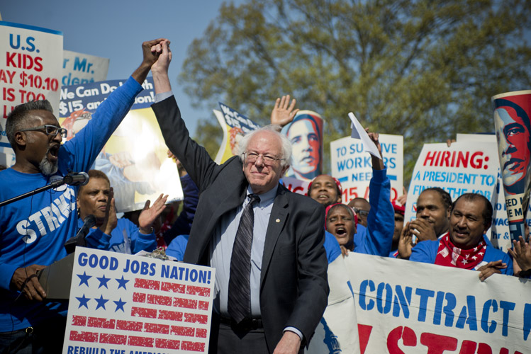 Bernie Sanders is cheered during a rally just outside the Capitol after speaking in support for an increase in the minimum wage to $15-dollars-an-hour. After Sanders announced his campaign, many of the liberal Democrats who gravitated to Elizabeth Warren and unsatisfied with front-runner Hillary Clinton turned their attention towards the self-identified socialist from Vermont.