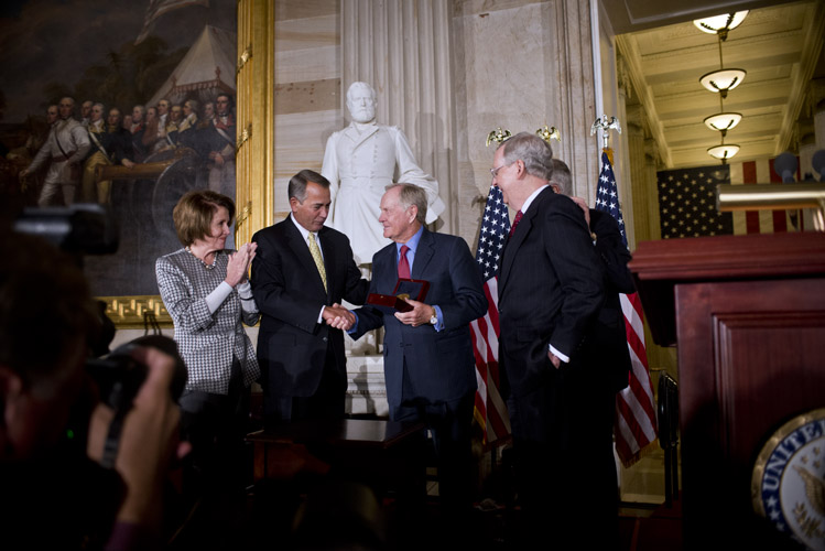 Boehner presents professional golfer Jack Nicklaus with the Congressional Gold Medal during a ceremony with the rest of the congressional leadership inside the Capitol Rotunda.