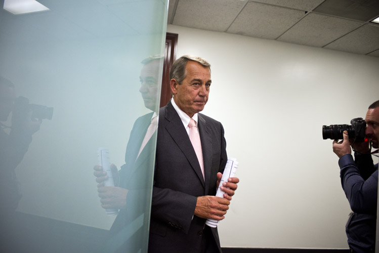 Boehner arrives for a press conference where reporters ask if the Speaker can successfully pass the Obama Administration's request for fast-track authority to negotiate the TPP trade deal. Boehner supported the bill, but many Republicans were loathe to hand Obama greater powers and many Democrats had deep reservations on the deal. In the end, Boehner was able to keep his caucus together in support of the legislation, but the bill failed nonetheless. In a twist, it was Democrats who sank a bill the President supported.