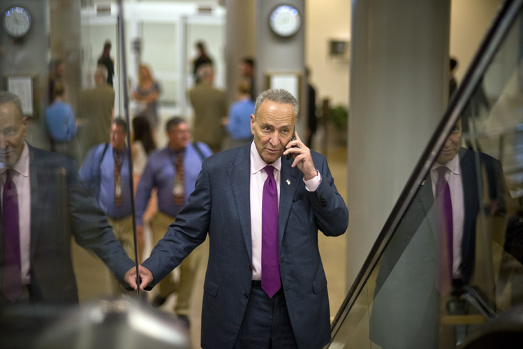 Sen. Chuck Schumer (D-N.Y.) walks through the Capitol basement, on his way to the weekly policy luncheon with the Democratic caucus.