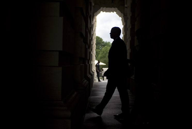 Sen. Cory Booker (D-N.J.) returns to the Capitol through the Senate carriage doors after attending a prayer circle on the west lawn in honor of Charleston shooting victims. The night before, a gunman entered Emanuel African Methodist Episcopal Church in Charleston, S.C. and killed nine people.