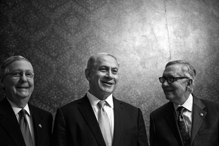 Israeli Prime Minister Benjamin Netanyahu, center, meets with the Senate leadership following his controversial joint-address. He began his remarks with praise for Minority Leader Harry Reid (D-Nev.), right, saying