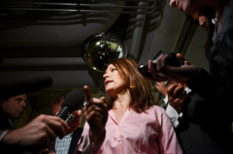 Rep. Michele Bachmann (R-Minn.) emerges from a Republican caucus meeting explaining she will switch her vote from 'nay' to 'yea' after the GOP leadership addressed concerns over a bill that addressed the surge in children crossing the border with Mexico. Bachmann and other conservatives threatened to revolt against any bill seen as giving tacit approval to the Obama Administration's response to the border crisis.
