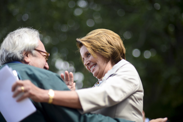 Rep. Nancy Pelosi (D-Calif.) greets a supporter before speaking at a rally to drum up support amongst Democratic voters before the upcoming midterm elections. Pelosi declared that Democrats would prevent any Republican effort to enact cuts to Social Security and other social safety net programs.