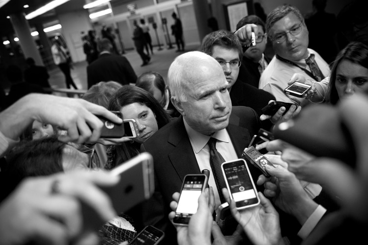 Sen. John McCain (R-Ariz.) is surrounded by a gaggle of press reporters in the Capitol underground. McCain, the chairman of the Senate Armed Forces Committee, was asked about the National Defense Authorization Act under debate in the Senate.