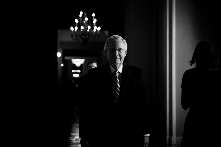 Senate Majority Leader Mitch McConnell proceeds from his Capitol office towards the Senate chamber.
