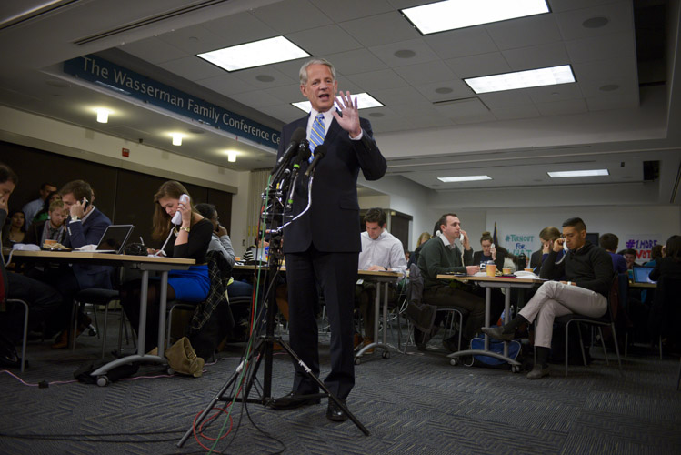 Rep. Steve Israel (D-N.Y.), the chairman of the Democratic Congressional Campaign Committee, speaks with reporters as Democratic volunteers continue to call voters behind him before polls close throughout the east coast. Exit polling indicated that the 2014-midterm elections would inflict big losses on the Democrats.